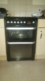 Black 4 ring Hotpoint dual fuel cooker