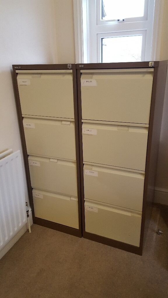 Four drawer metal filing cabinet with suspension folders included