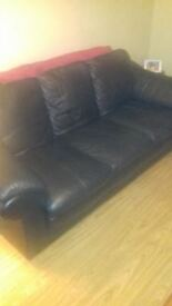 3+1+1 black leather sofa, excellent condition.