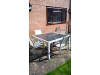 Garden Table and Six chairs with large black umbrella
