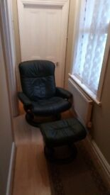 Ekornes green leather reclining armchair and footstool. Excellent condition. Collection only