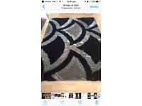 Black/silver large gray rug