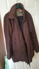 Musto man's coat. Brown size xxxl. 2 handwarmer & 2 front patch pockets. Pristine condition.