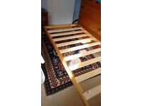 Bed, single, collapsing legs on castors, to enable the bed to be pushed under another bed.