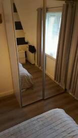 Mirrored sliding wardrobe