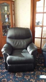 Leather electric recliner in Black. Chair as new.