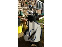Pure spin golf bag and various clubs