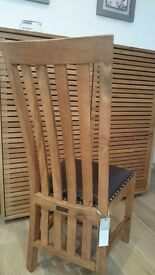 2 reclaimed teak and leather dining chairs from Raft Furniture