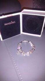 Pandora bracelet + 16 charms