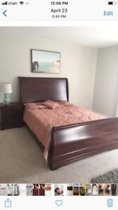 Queen bed with side table