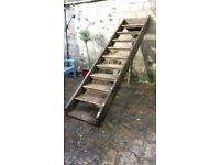 Wooden steps previously used to access deck.
