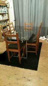 Glass table n 6 pine chairs