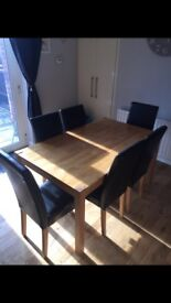 Oak dining table and 6 black leather chairs