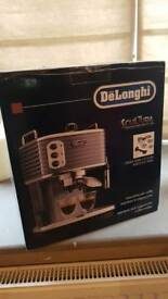 Delonghi scultura coffee machine..