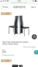 Six black leather dining chairs and black dining table