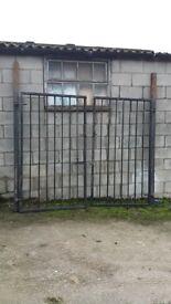Pair of large black metal gates