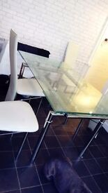 Glass dining room table good condition selling as got new one