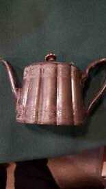 Two old metal teapots