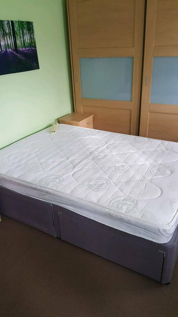Double divan bed withside drawers and mattress