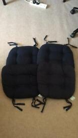 Four tie on seat covers ideal for the garden or kitchen dining chairs
