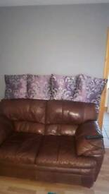 Four purple and silver cushions