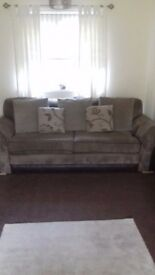 Cord sofas for sale good cond. Selling due to moving. 2 puffys with it