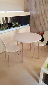Bistro table and three chairs