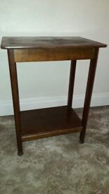 Solid dark wood tall occasional table