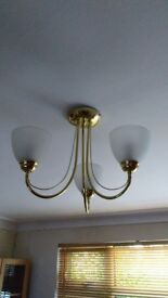 Room and matching wall lights, brass, curved arms with pearl glass bulb housings.