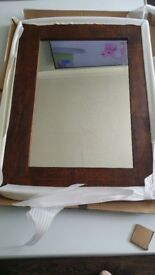 BRAND NEW from John lewis a solid wooden mirror absolutely stunning mirrow .