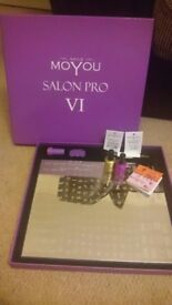 Mo You Salon Pro VI with 2 bottles of nail polish and rhinestones