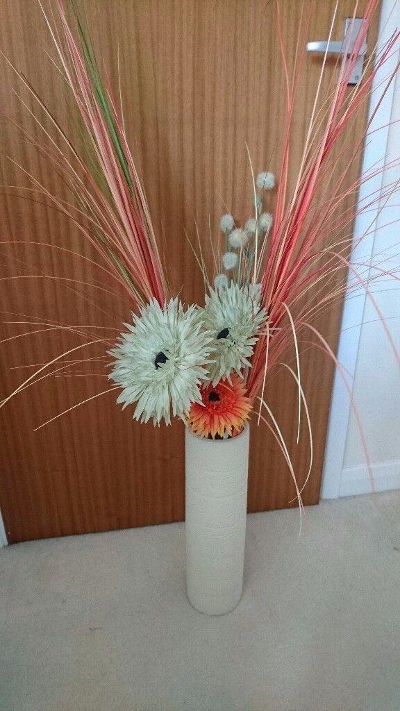 Cream vase with imitation flowers