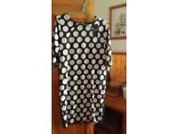 Vertigo black and cream spotted dress tags on dress
