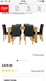 6-8 seater extendable oak table with 6 black faux leather chairs excellent condition