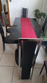 Glass top Dining Table and 6 leather chairs