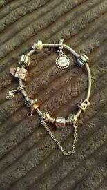 Pandora bracelet with charms and safety chain