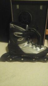 Almost new Salomon inline skates, size 11 incl RSI knee and wrist protection