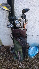 Golf clubs , bag and trolley