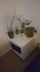 White Ikea side table on wheels