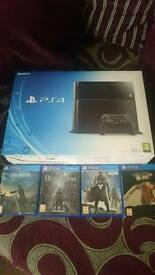 Playstation 4 console complete and boxed with 4 games