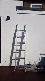 Near NEW- single story extension ladder.