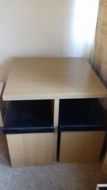 Table and storage chairs (one seat needs repair see photos)