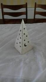 Pyramid tea light with star and moon cut outs