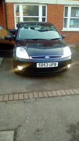 Black automatic 1.4 clean in and out drives well mot till March 2017