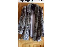 Ladies fake fur coat.