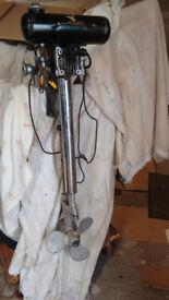 Three vintage Seagull outboard motors