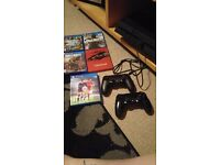 PS4 1TB with 2 controllers and 5 games