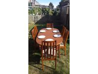 Wooden extendable table and 6 chairs
