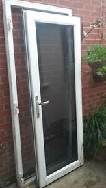 White UPVC door large glass panel