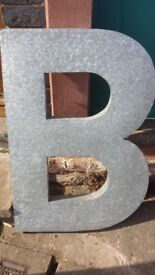 Large metal letter 'B'